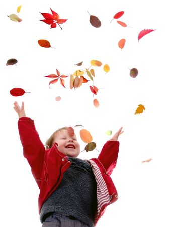 The cheerful little boy throws autumn leaves on a white background Stock Photo