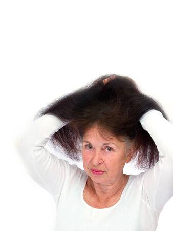 Lady hands slightly raises hair photo
