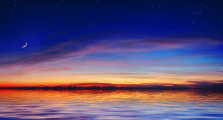 The quiet sea on a background of a beautiful sunset with the moon and stars Stock Photo