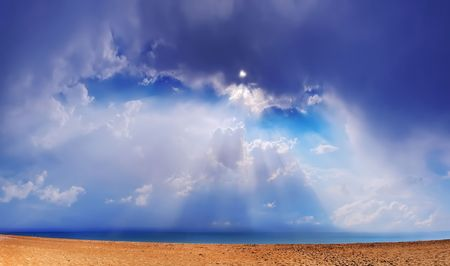 Beautiful sea landscape. Through clouds on the sea solar beams fall. photo