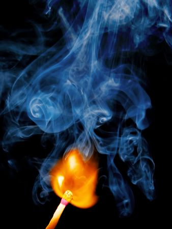 Burning match and smoke from it on a black background Stock Photo - 617720