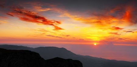 Meeting of a dawn highly in mountains, the beautiful sea and clouds photo