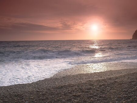 sunset on a background of the storm sea Stock Photo - 742591