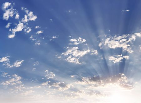 Solar beams make the way through clouds  Stock Photo