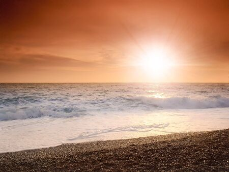 sunset on a background of the storm sea Stock Photo - 2038632