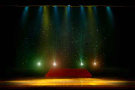 stage lighting: Theater stage with curtains and spotlights. Theatrical scene in the light of searchlights, the interior of the old theater. Light stage spotlights. Stock Photo