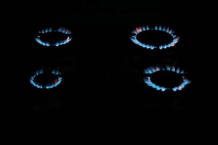 Four burners lighted with a flickering flame