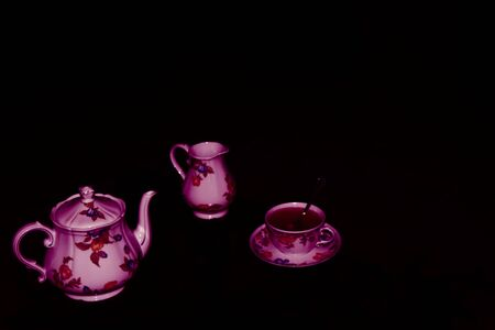 Tea time - Set for tea with ceramic tea pot, cup and milk jug hand painted in flowery style