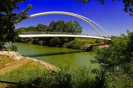 Getting out lockdown - People cycling across a bridge on a bicycle path in Spring - Maremma Regional Park - Tuscany - Italy