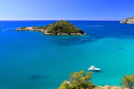 View from the coastline with a powerboat and a small island - Isolotto - Porto Ercole - Tuscany - Italy