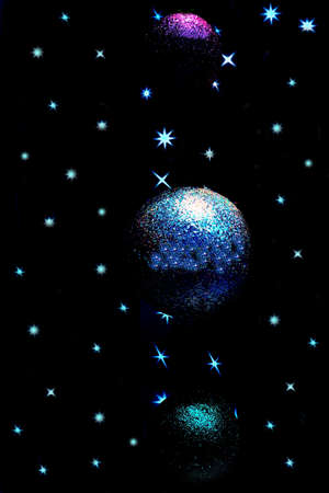 Christmas atmosphere: Christmas balls decorated a window shop in a starry dark sky