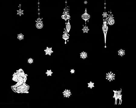 Christmas atmosphere: Christmas balls, snow flakes and other decorations in a shop with a black background