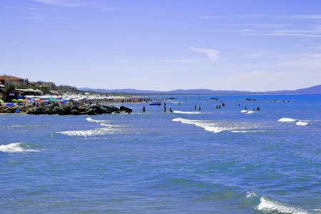 People relaxing by seaside in a tourist location - Castiglione della Pescaia - Tuscany - Italy