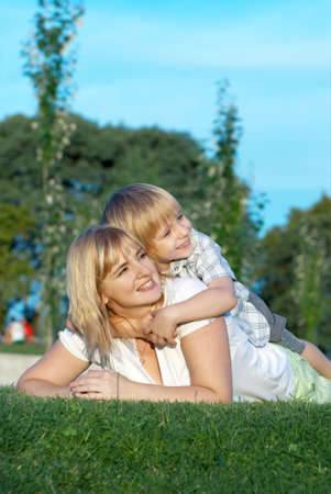 Mother and son playing on green grass Stock Photo - 5450012