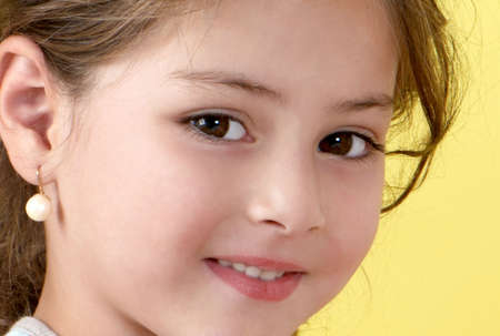 Happy little girl  a on yellow background Stock Photo - 5465806