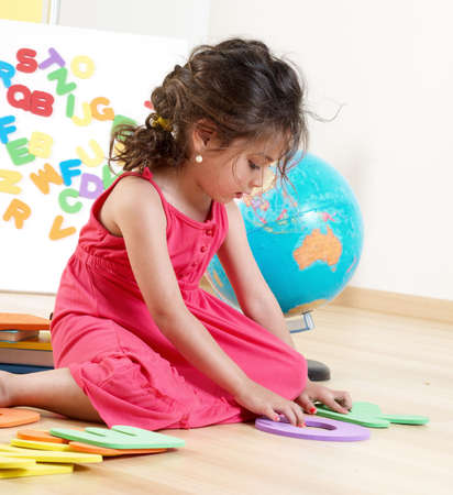The little girl with Letters Stock Photo