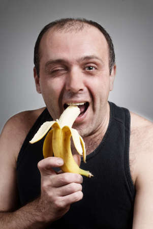 Comic portrait of the cheerful person with a banana photo