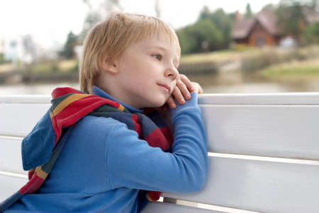 non urban 1: The dreaming little boy on a bench.