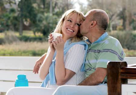Happy couple on a bench in park Stock Photo - 5465883