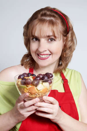 The beautiful women with fruit salad Stock Photo - 5464488