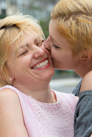 The young girl kissing  mother. Emotions Stock Photo - 5465432