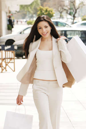 The beautiful young girl with a shopping Bag Stock Photo