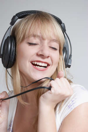 happy teenage girl in headphones Stock Photo - 5482122
