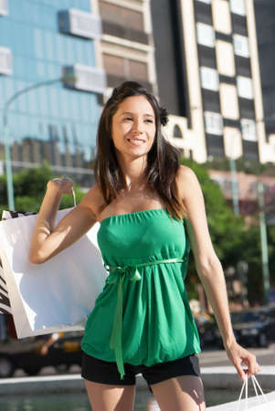 shopping scenes: The beautiful young girl with a shopping Bag Stock Photo