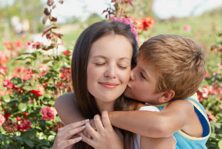 mother nature: The son kissing mother. The womens day