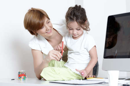 Mother with a little daughter at office on a workplace Stock Photo - 5482154