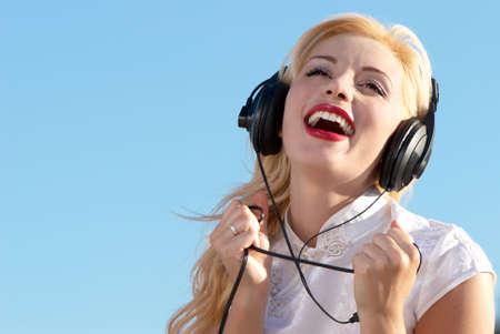 happy women in headphones Stock Photo - 5482379
