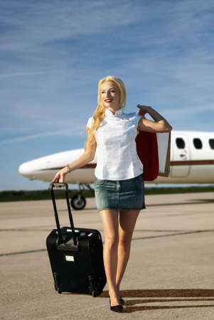 model airplane: The girl with luggage going from plane