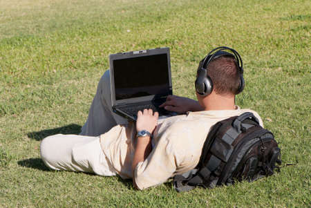 Boy using notebook outdoor Stock Photo
