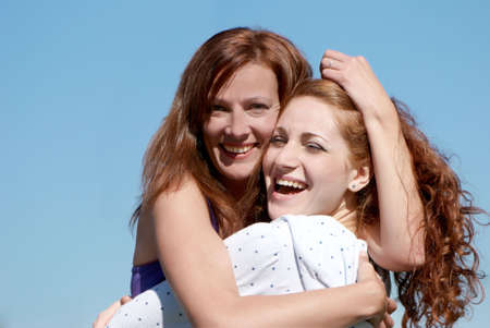 A young happy girl with mother Stock Photo - 5482393