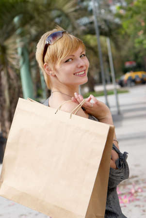 Portrait of an attractive young  women with a shopping Bag photo