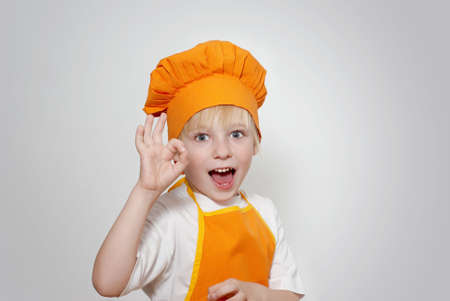 Portrait of the little cook  photo