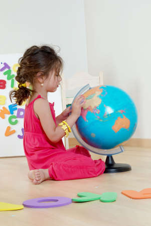 The little girl with globe photo