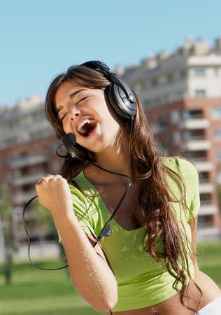 happy teenage girl in headphones Stock Photo - 5482160