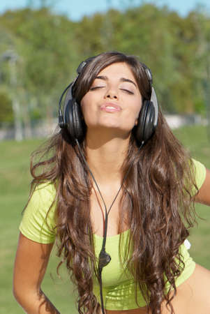 happy teenage girl in headphones Stock Photo - 5482289