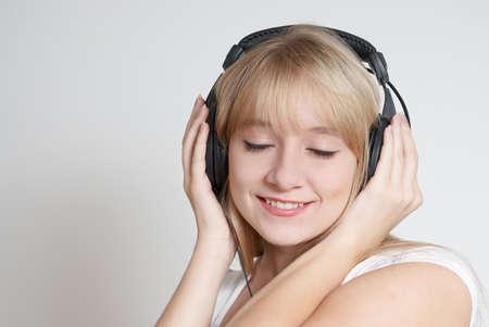 happy teenage girl in headphones Stock Photo - 5496681