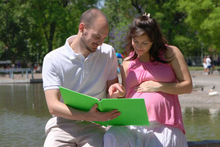 Happy beautiful pregnant woman and her husband photo