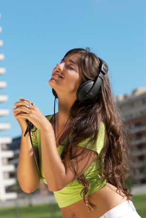 happy teenage girl in headphones Stock Photo - 5496600