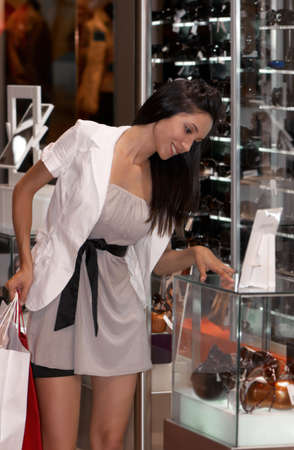 The beautiful young girl in prestigious shop photo