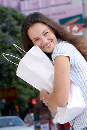 Portrait of an attractive young  women out shopping photo