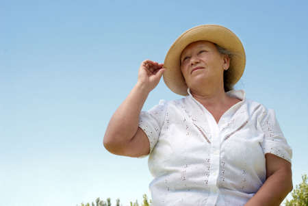 Portrait of the elderly woman against the sky Stock Photo - 5496660