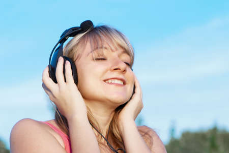 happy teenage girl in headphones photo