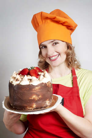 The beautiful cook with a pie in hands photo