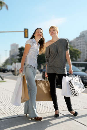 Two emotional girls with a shopping Bag photo