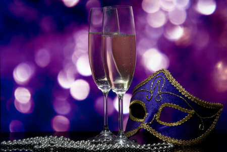 lasses with champagne and Venetian mask  photo