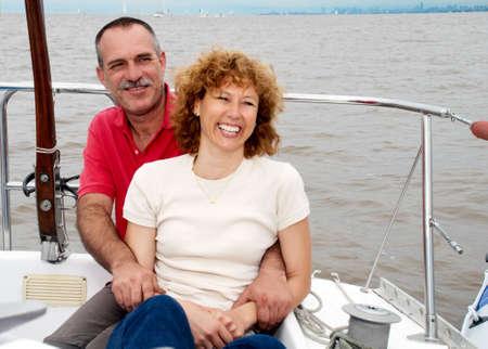 Elderly happy couple onboard the yacht photo